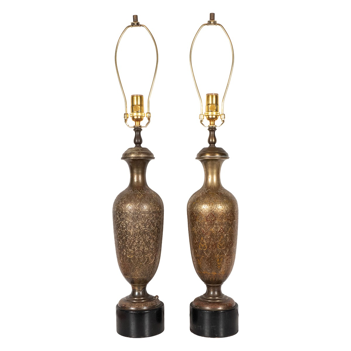 Pair of intricately etched brass table lamps